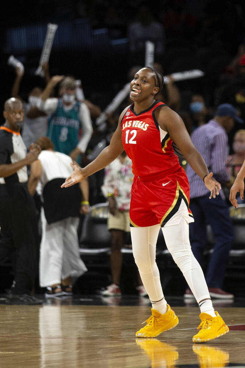 Las Vegas Aces guard Chelsea Gray (12) celebrates a three-pointer during the second half of a W ...