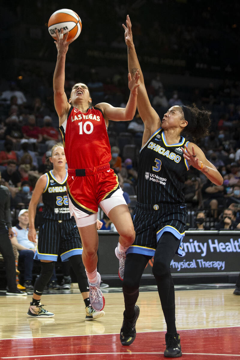Las Vegas Aces guard Kelsey Plum (10) goes up for a layup as Chicago Sky forward/center Candace ...
