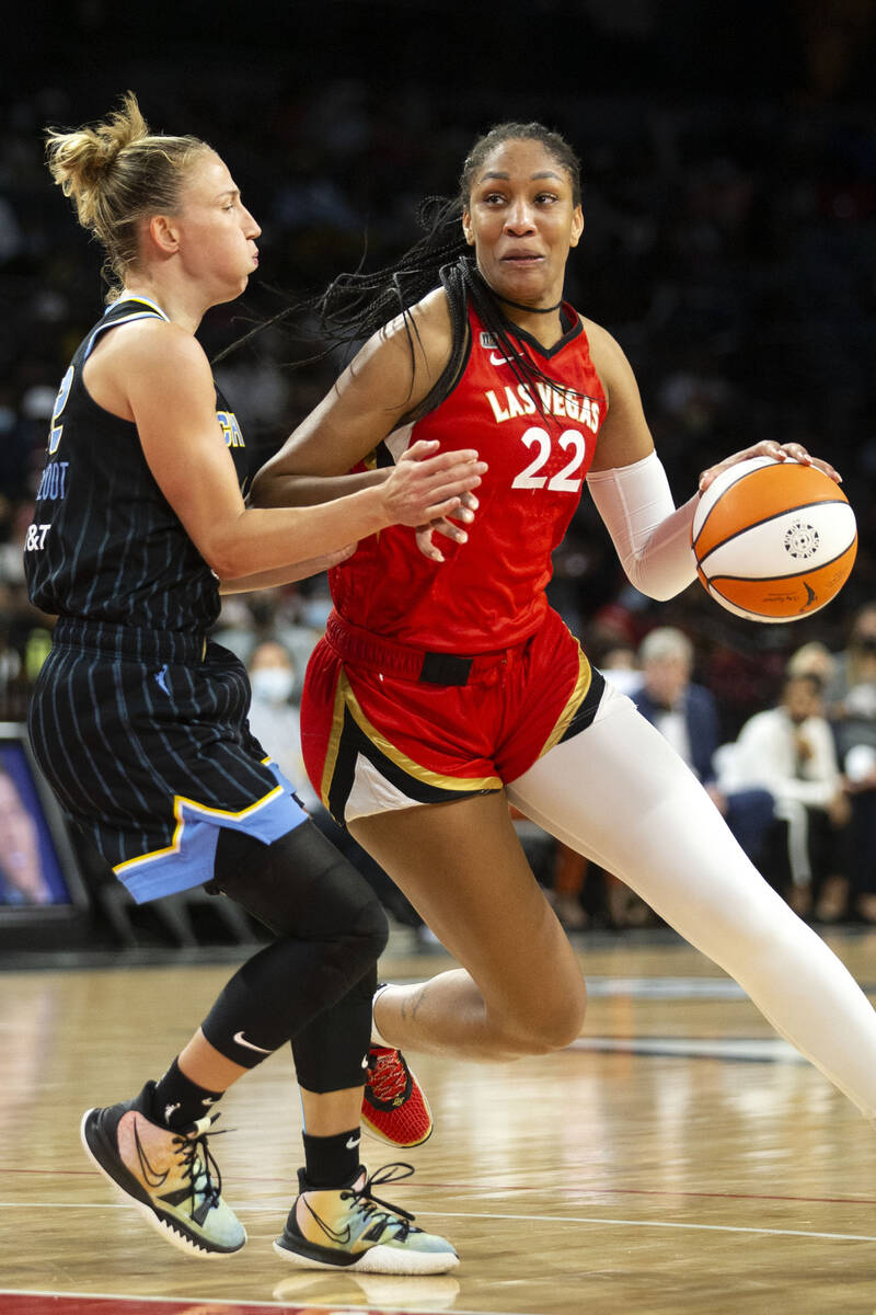 Las Vegas Aces forward A'ja Wilson (22) dribbles around Chicago Sky guard Courtney Vandersloot ...