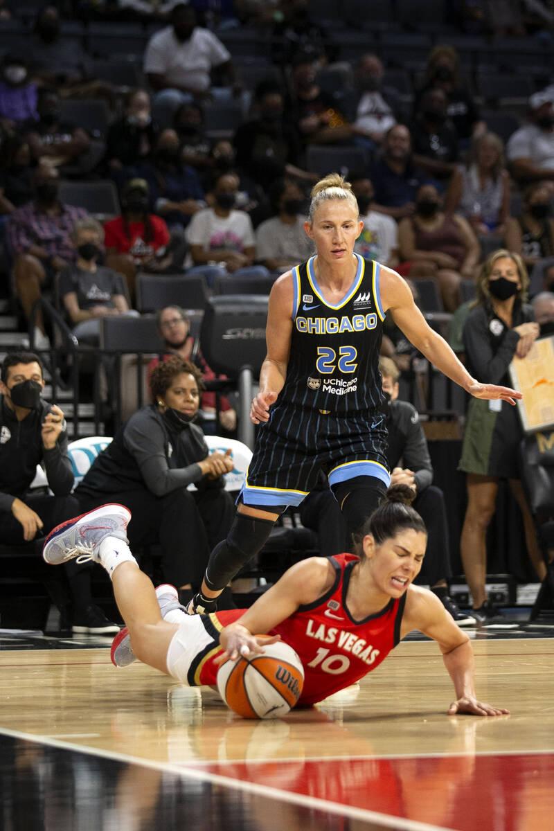 Las Vegas Aces guard Kelsey Plum (10) hits the ground as Chicago Sky guard Courtney Vandersloot ...
