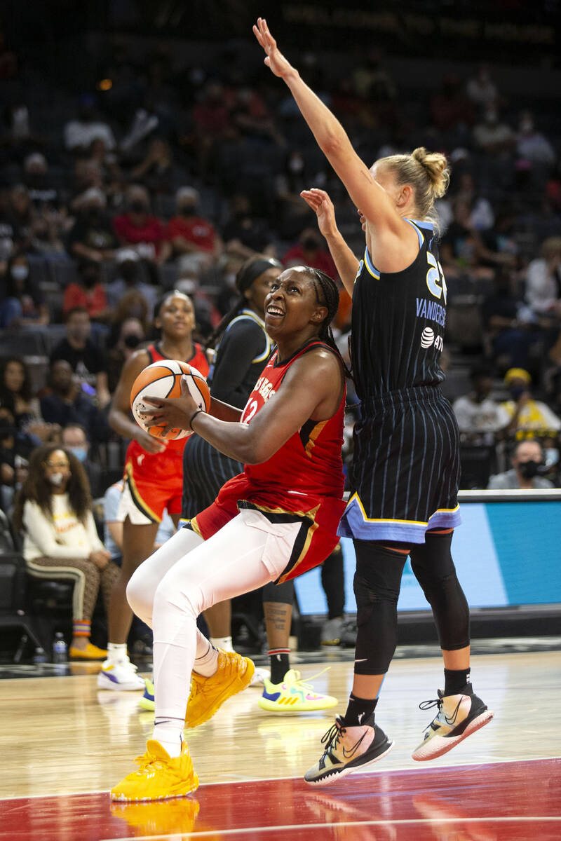 Las Vegas Aces guard Chelsea Gray (12) goes up for a shot guarded by Chicago Sky guard Courtney ...