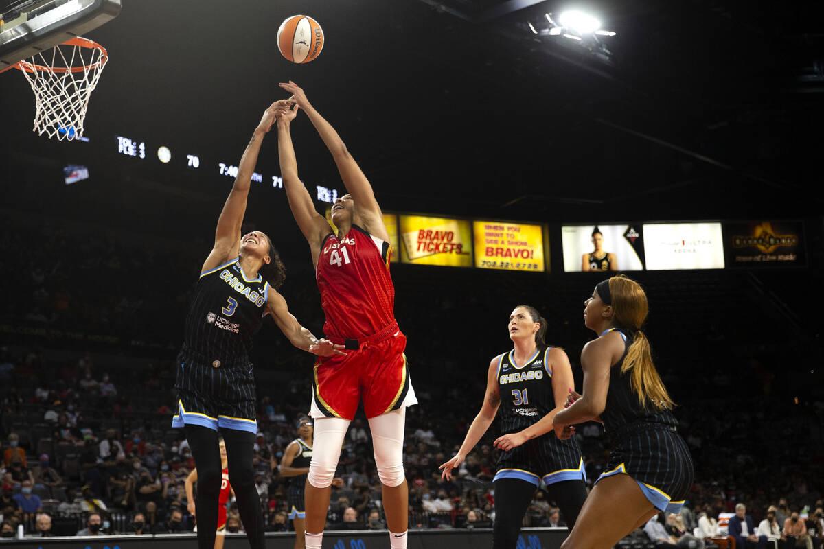 Chicago Sky forward/center Candace Parker (3) and Las Vegas Aces center Kiah Stokes (41) jump f ...