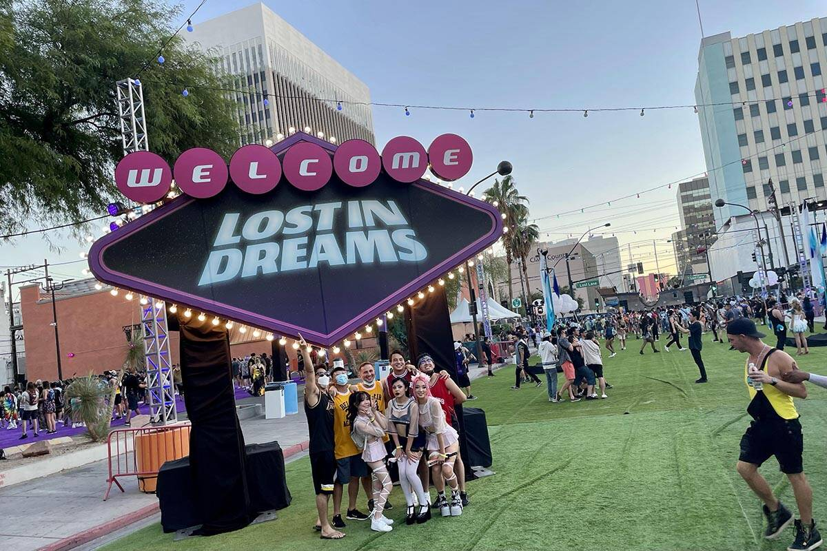 A group poses for photos near the front entrance of Lost in Dreams music festival at the Downto ...