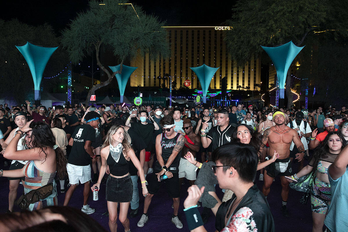 Fans dance to Devault's set during the Lost in Dreams music festival at the Downtown Las Vegas ...