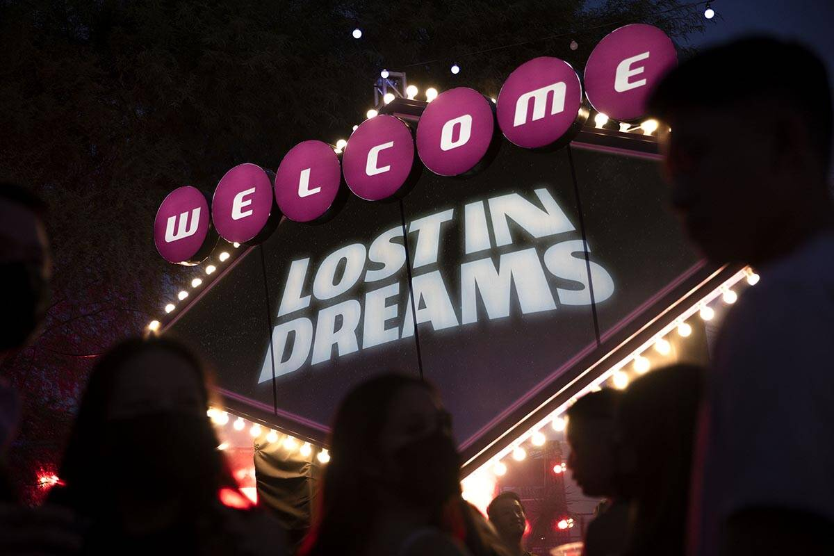Fans wait in line to take photos in front of the welcome sign during the Lost in Dreams music f ...