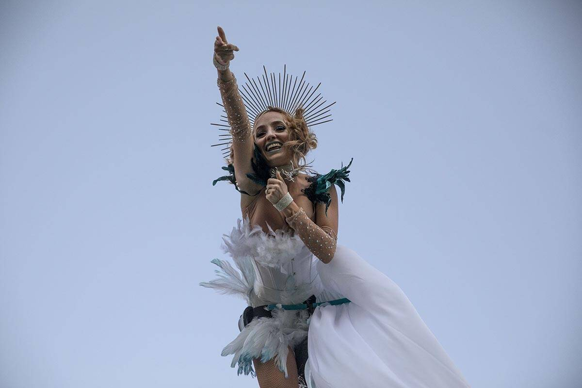 A performer with Sway Poles entertains attendees of the Lost in Dreams music festival at the Do ...