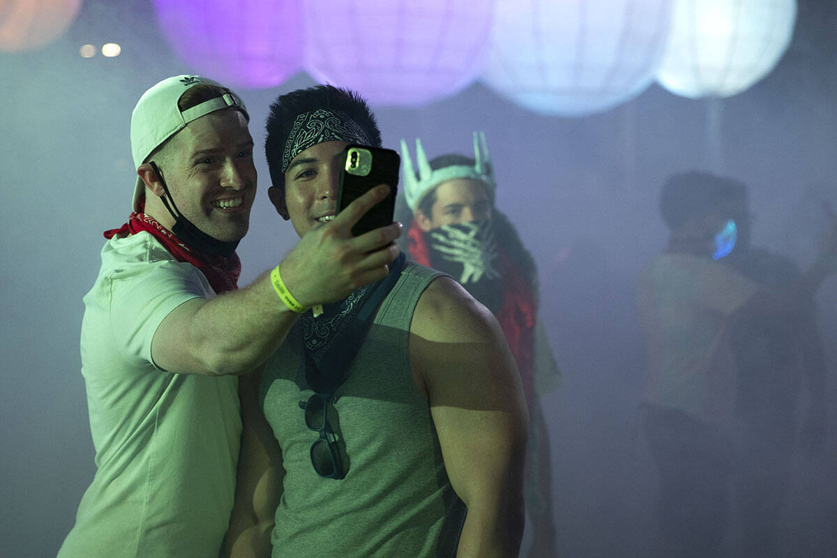 Jake Updegrove, left, and Mikel Delion, of Los Angeles, Calif., take a photo during the Lost in ...