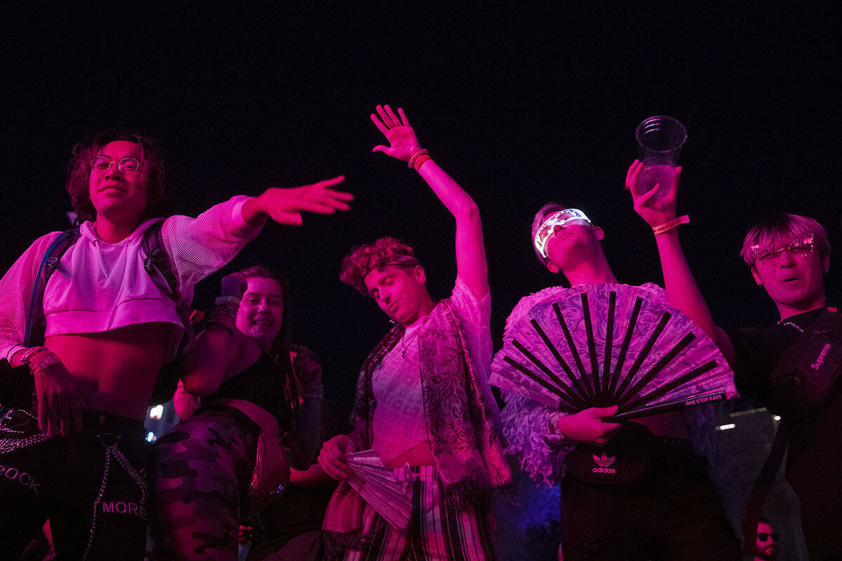 Fan's dance as the beat drops during Pluko's set at the Lost in Dreams music festival at the Do ...