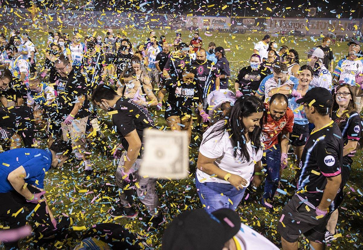 """People scramble for money during the annual """"$5,000 Cash Drop presented by Jarritos&#x20 ..."""