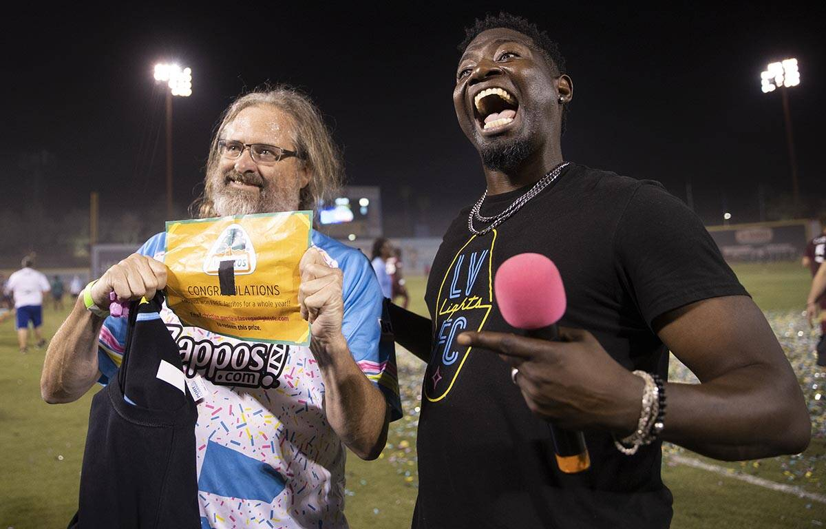 """Dave Beisecker, left, shows off the golden ticket he won during the annual """"$5,000 Cash ..."""