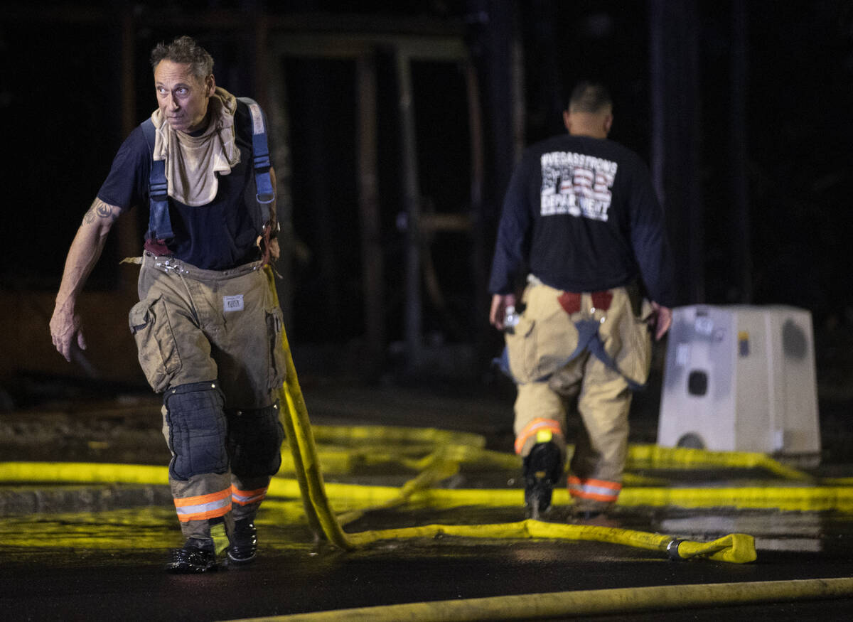 The Las Vegas Fire Department responds to the aftermath of a fire at 1026 S. Main Street on Sun ...