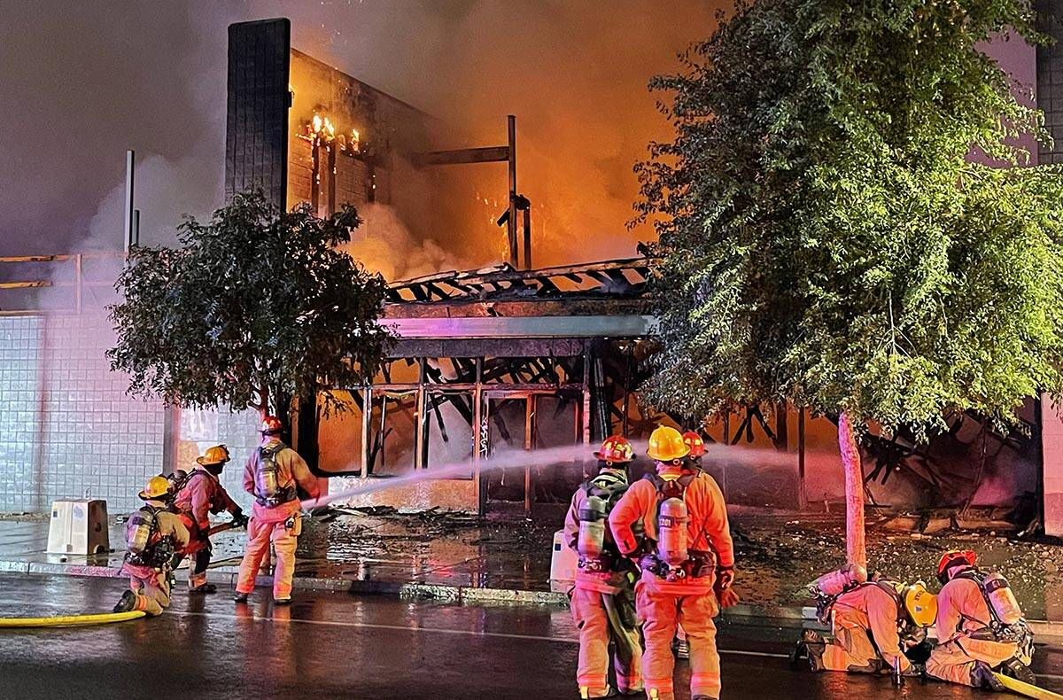 Firefighters extinguish a building fire on Commerce Street in downtown Las Vegas on Sunday, Sep ...