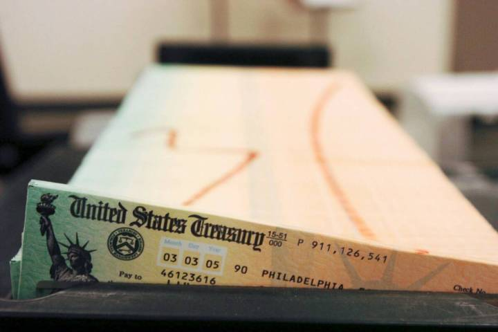 Trays of printed social security checks wait to be mailed from the U.S. Treasury's Financial Ma ...