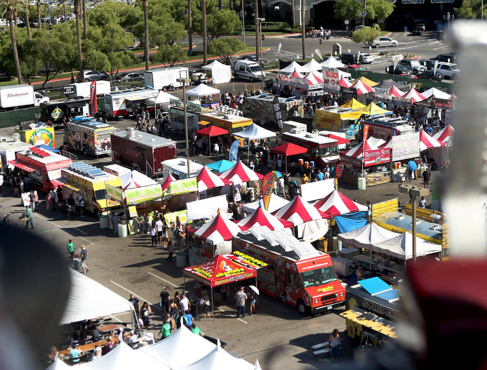 Different foods and events occur at the Great American Foodie Fest at the Sunset Station in Hen ...
