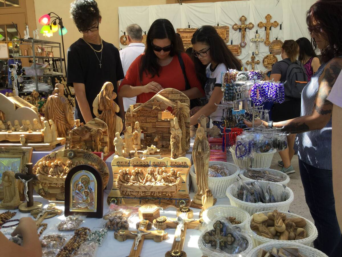 People shop during the 45th annual Greek Food Fest in Las Vegas, Sunday, Sept. 17, 2017. (Las V ...