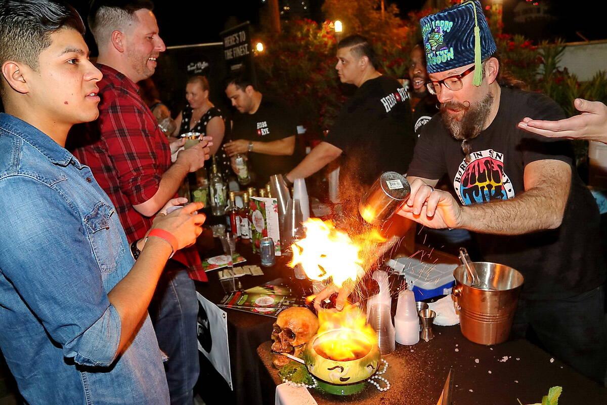 Adam Rains creates a cocktail at Vegas Unstripped 2019. (Hew Burney)