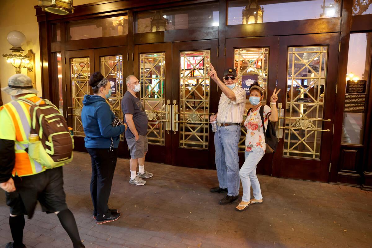 Lori Doane, from left, John Carollo, Ronald Rasmusson and Yong Cho, all of Las Vegas, wait outs ...