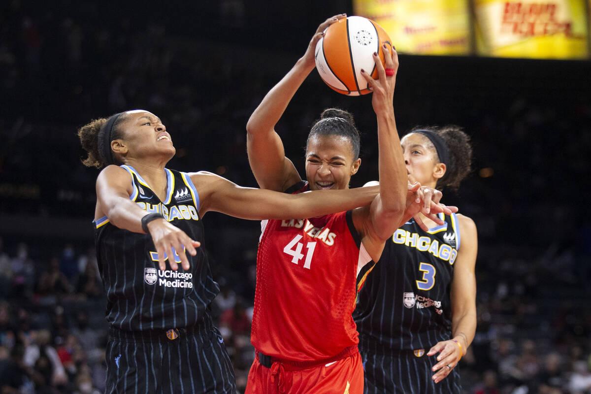 Las Vegas Aces center Kiah Stokes (41) gains control of the ball alongside Chicago Sky forward/ ...
