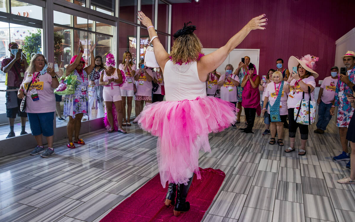 Attendees cheer for another contestant during a costume contest at the 1st Annual Flamingo Fan ...