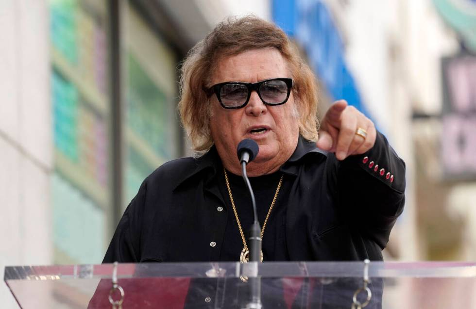 """""""American Pie"""" singer/songwriter Don McLean addresses the crowd during a ceremony to ..."""