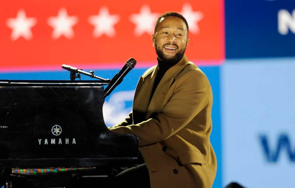 Performer John Legend plays the piano during a Get Out the Vote rally on Monday, Nov. 2, 2020, ...