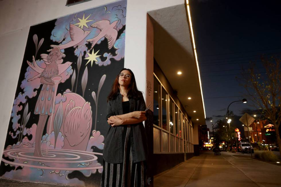 """Kim Sol with her mural """"Starlights & Rivulets"""" for the Life is Beautiful music, art and food fe ..."""