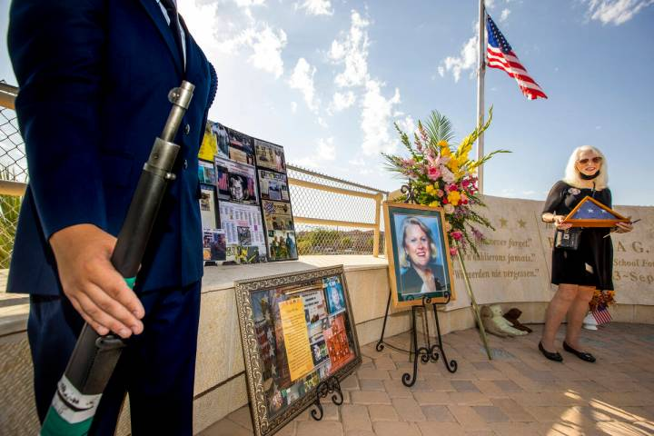 Retired Palo Verde High School teacher Gail Fahy holds an American flag after a ceremony honori ...