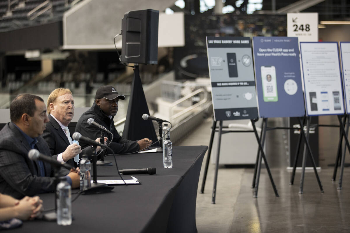 Las Vegas Raiders president Dan Ventrelle, from left, owner Mark Davis, and CLEAR'S senior vice ...