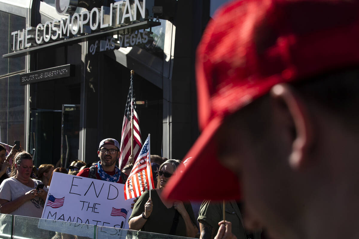 Protesters demonstrate outside of The Cosmopolitan during an anti-mask, anti-vaccination and fr ...
