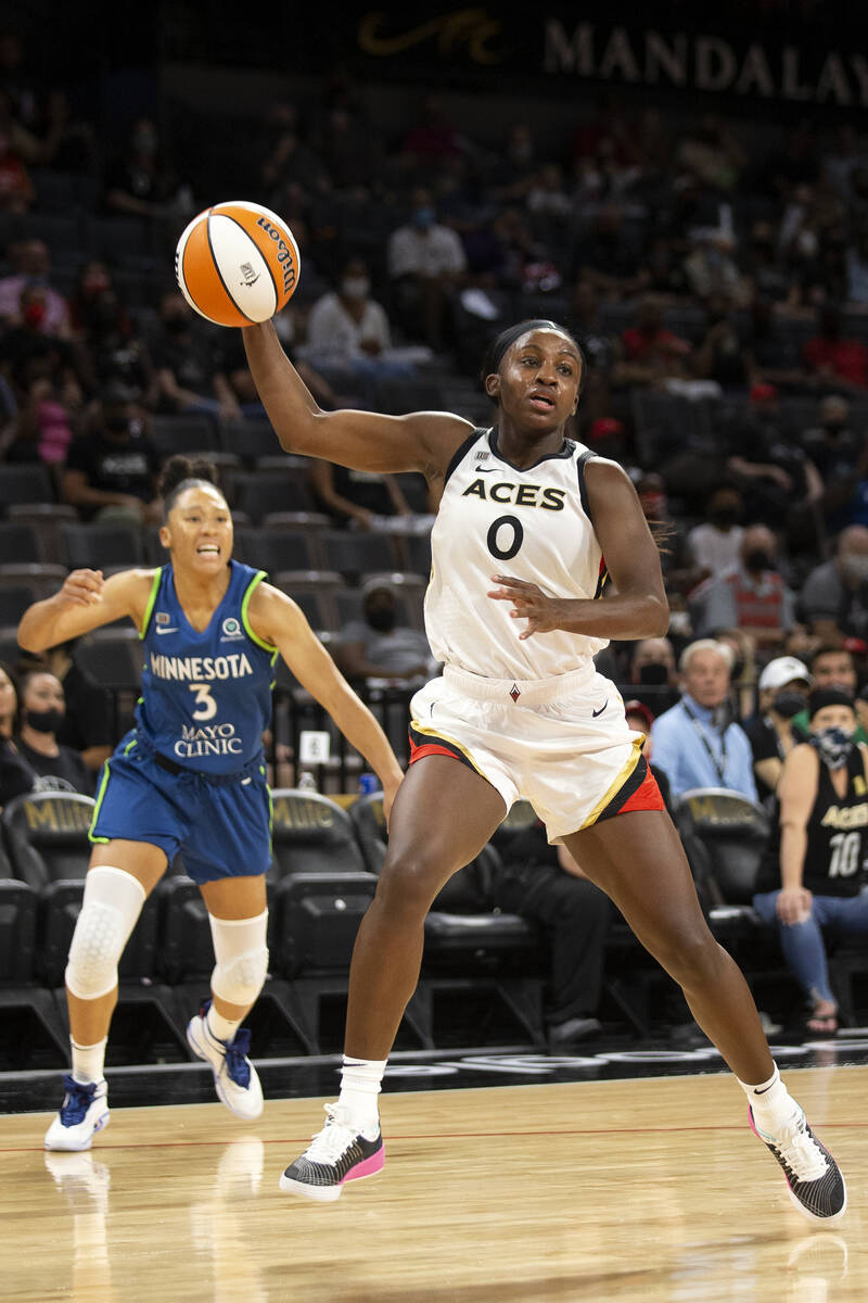 Las Vegas Aces guard Jackie Young (0) regains control of the ball while Minnesota Lynx forward/ ...