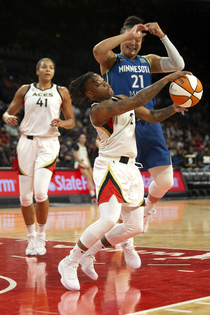 Las Vegas Aces guard Riquna Williams (2) gains control of the ball from Minnesota Lynx guard Ka ...