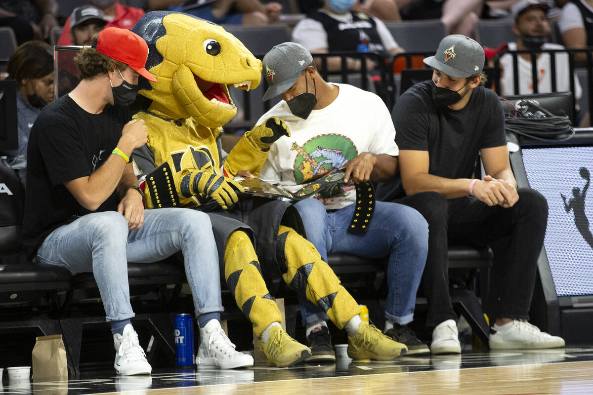 Vegas Golden Knights players Dylan Coghlan, left, the Knights' mascot Chance, Keegan Kolesar an ...
