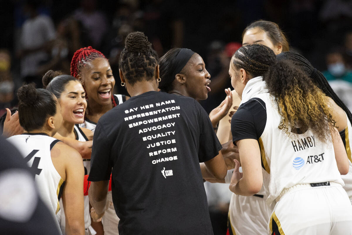 The Las Vegas Aces surround guard Jackie Young (0) after she scored 29 points, her career high, ...