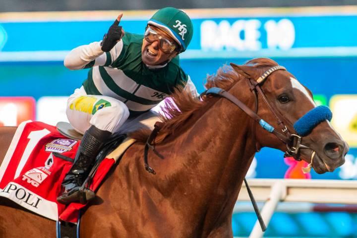 In a photo provided by Benoit Photo, Tripoli and jockey Tiago Pereira win the $1 million TVG Pa ...