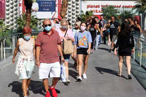 Labor Day weekend crowds on the pedestrian bridge between The Cosmopolitan of Las Vegas and Pla ...