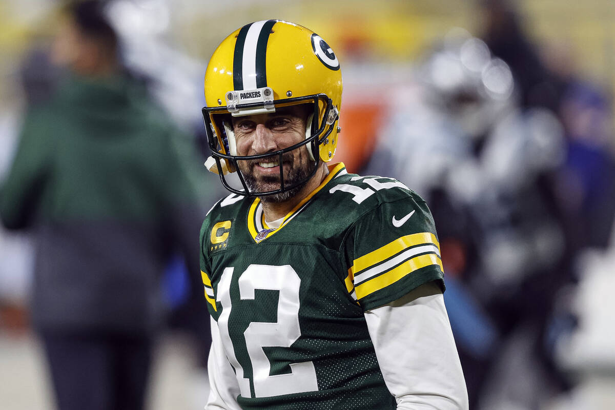 FILE - In this Dec 19. 2020, file photo, Green Bay Packers quarterback Aaron Rodgers (12) smile ...