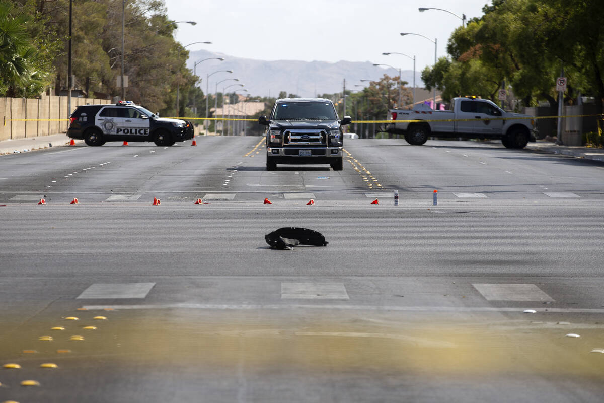 Las Vegas police respond to the scene of a fatal car accident at the intersection of West Flami ...