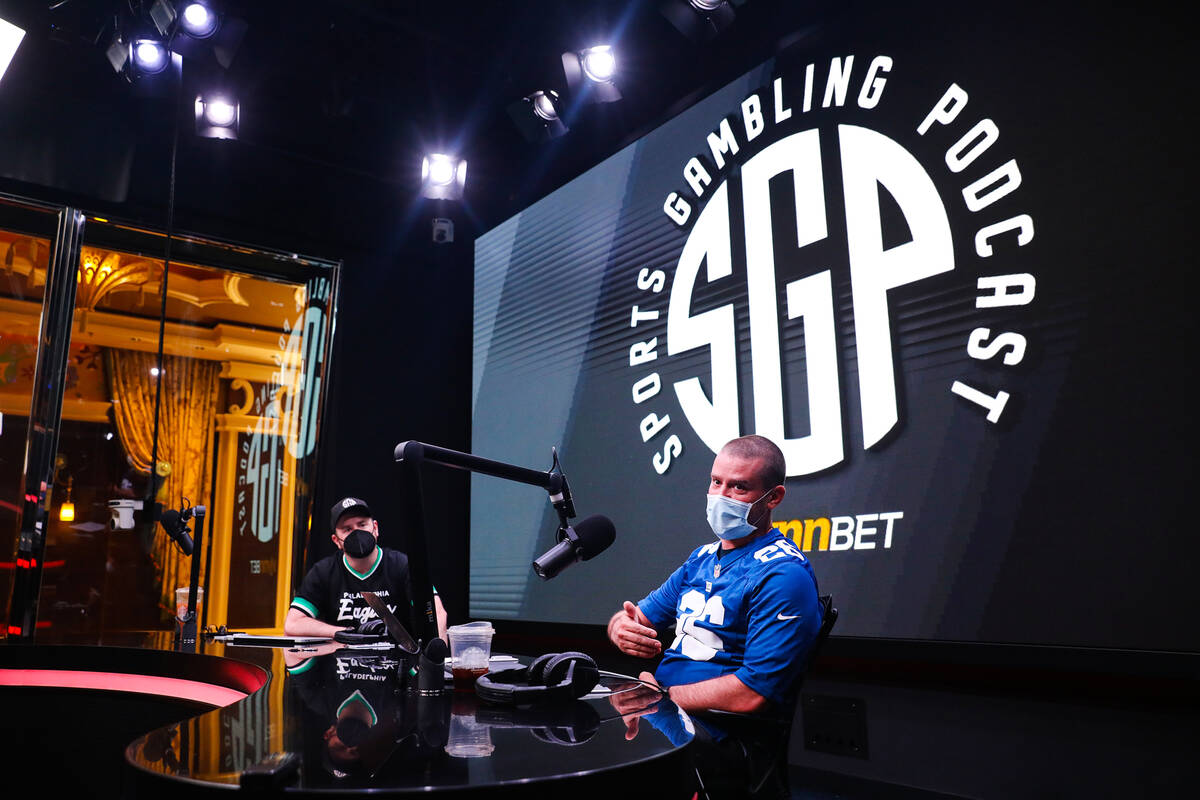 Sean Green, left, and Ryan Kramer, right, hosts of the Sports Gambling Podcast, speak to the Re ...