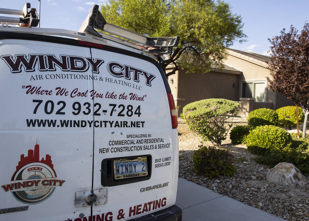 A Windy City Air's van is parked outside a house where Thomas Padron, a technician, repairs an ...