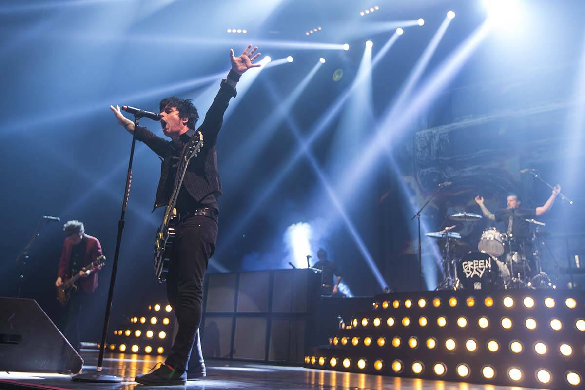 Billie Joe Armstrong, left, and Tre Cool of Green Day perform at the MGM Grand Garden Arena in ...