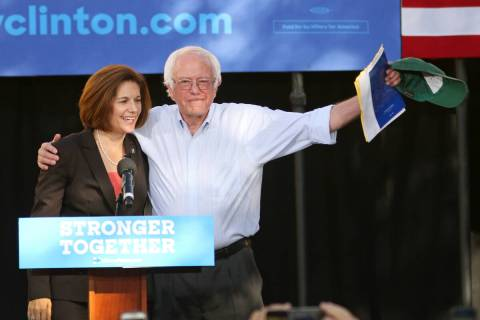 Vermont Sen. Bernie Sanders, right, embraces Nevada U.S. Senate Democratic candidate Catherine ...