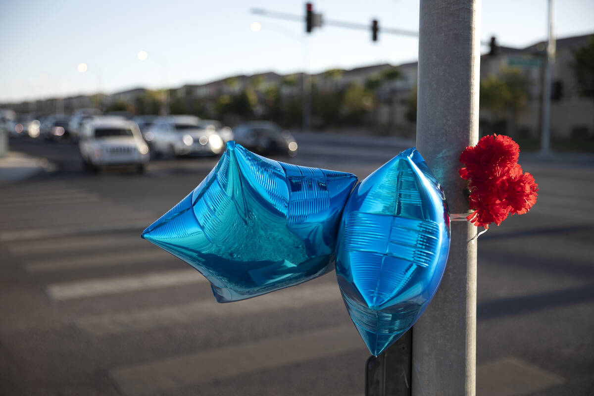 A memorial with balloons and flowers is seen at intersection of West Robindale Road and South D ...