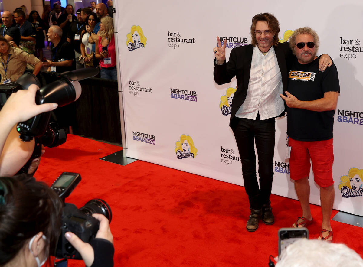 Rick Springfield, left, and Sammy Hagar walk the red carpet as the show floor opens for the Nig ...