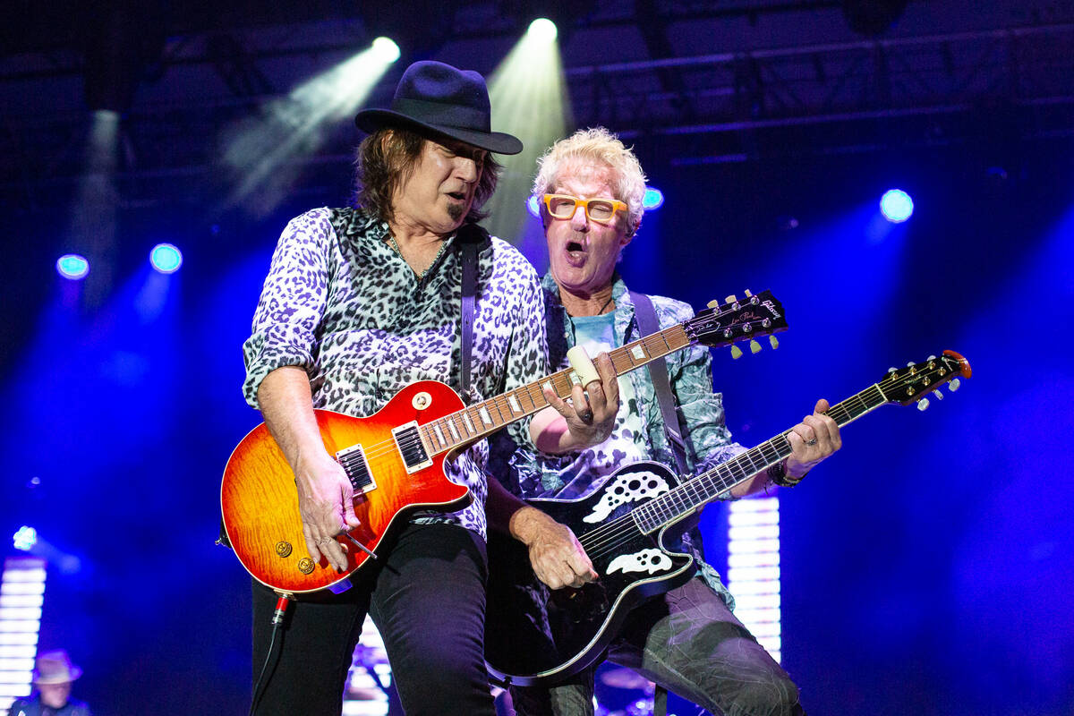 Gary Orton, left, and Kevin Cronin of REO Speedwagon perform at Sandbar Poolside at Red Rock Re ...