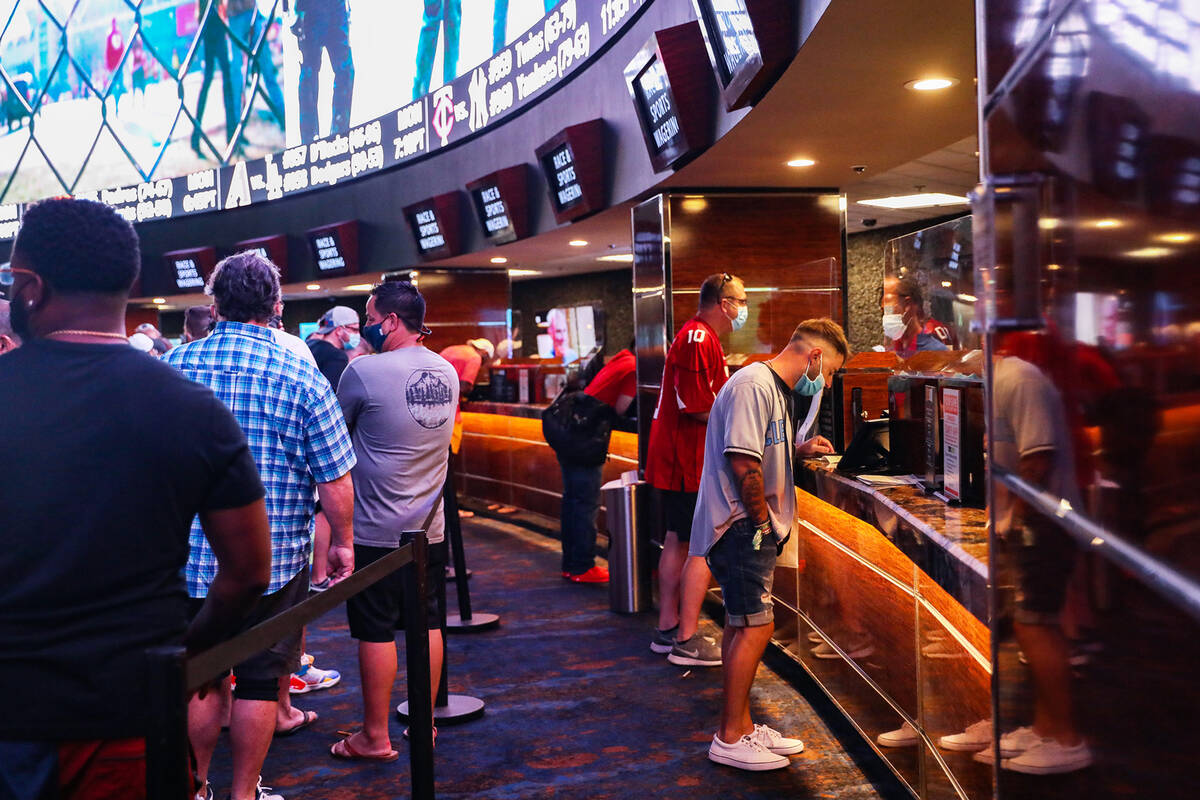 Guests place their bets at the Sports Book at Westgate in Las Vegas, Sunday, Sept. 12, 2021. (R ...