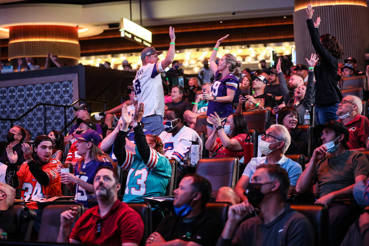 Guests react to a play while watching the Pittsburgh Steelers against the Buffalo Bills at the ...