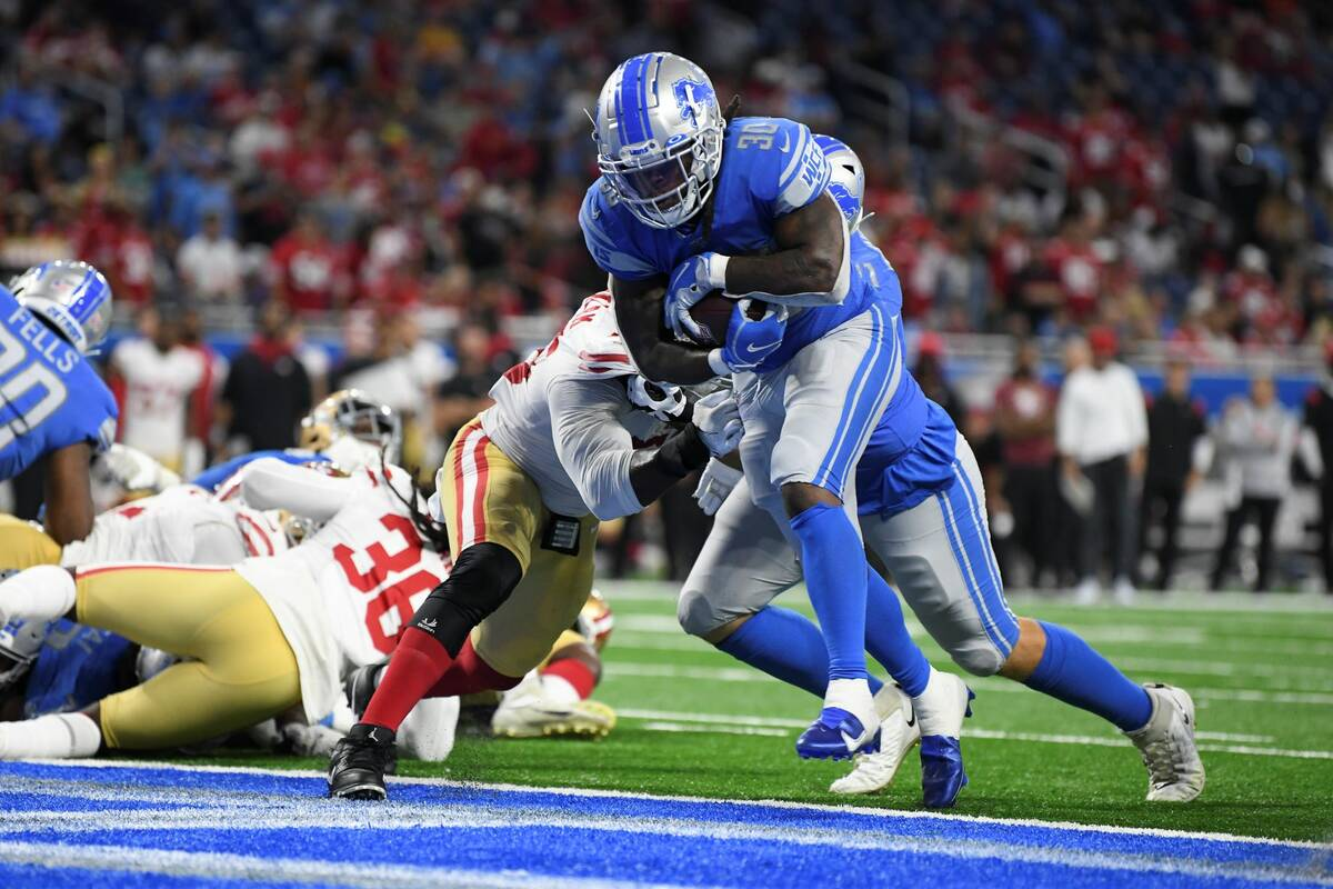 Detroit Lions running back Jamaal Williams (30) runs for a one-yard touchdown against the San F ...