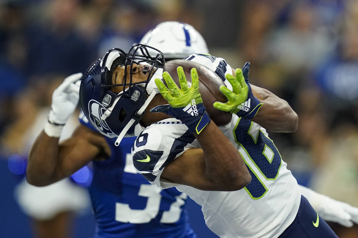 Seattle Seahawks wide receiver Tyler Lockett (16) makes catch for a touchdown in front of India ...
