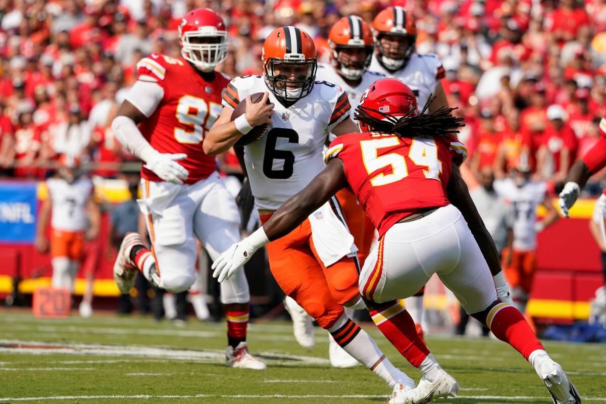 Cleveland Browns quarterback Baker Mayfield (6) scrambles as Kansas City Chiefs linebacker Nick ...