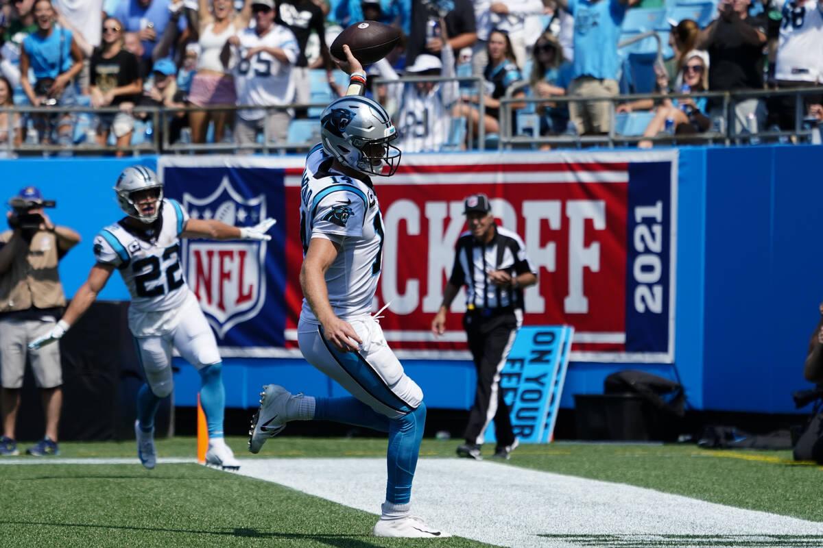 Carolina Panthers quarterback Sam Darnold celebrates after scoring against the New York Jets du ...
